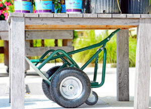 Read about the Potwheelz garden hand truck features - easily store the medium Potwheelz under a garden bench.